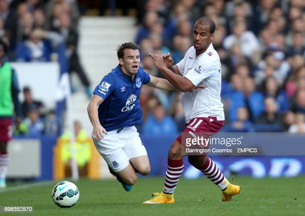 Everton's Seamus Coleman and Aston Villa'a Gabriel Agbonlahor battle for the ball