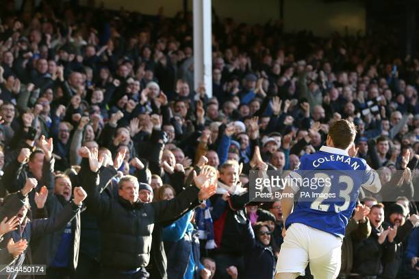 Everton's Seamus Coleman celebrates scoring their first goal of the game in front of jubilant supporters