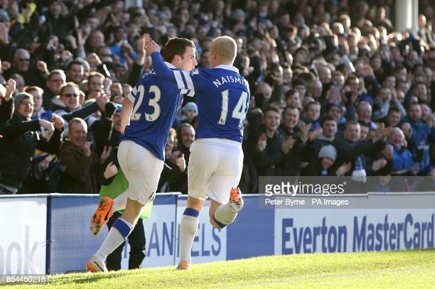 Everton's Seamus Coleman celebrates scoring their first goal of the game with teammate Steven Naismith