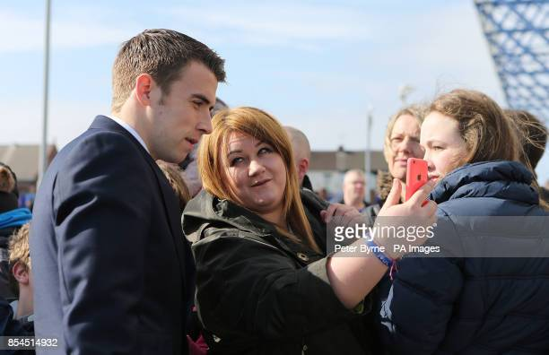 Everton's Seamus Coleman stops for photo with fans outside Goodison Park before the game