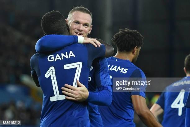 Everton's Senegalese midfielder Idrissa Gueye celebrates with Everton's English striker Wayne Rooney after scoring their second goal during the UEFA...