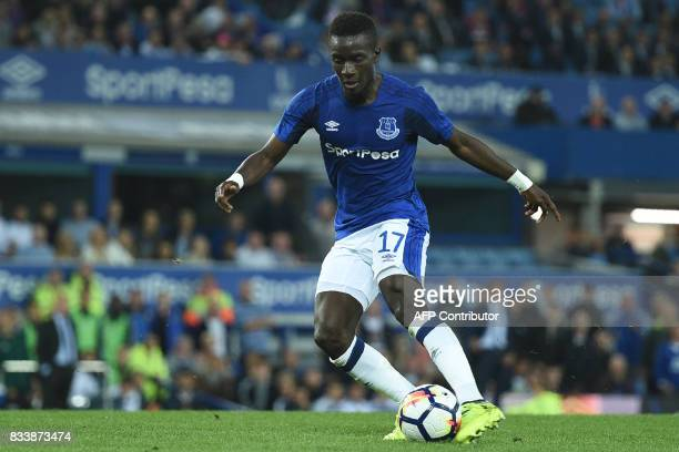 Everton's Senegalese midfielder Idrissa Gueye shoots to score their second goal during the UEFA Europa League playoff round first leg football match...