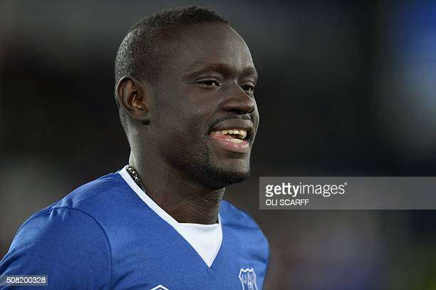 Everton's Senegalese striker Oumar Niasse greets the crowd on the pitch before the English Premier League football match between Everton and...