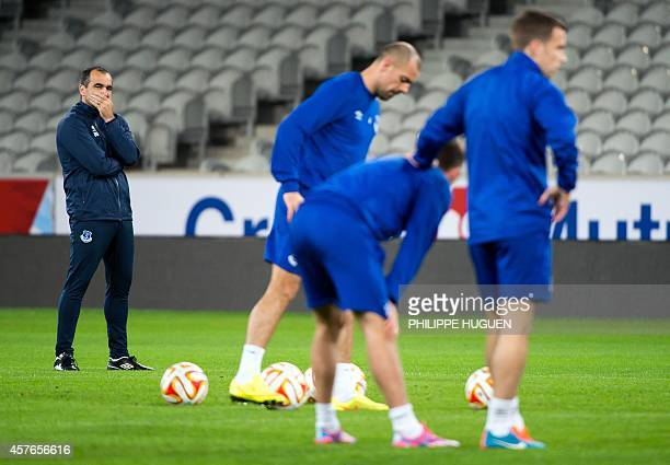 Everton's Spanish coach Roberto Martinez looks on during a training session at the Pierre Mauroy Stadium in Villeneuved'Ascq northern France on...