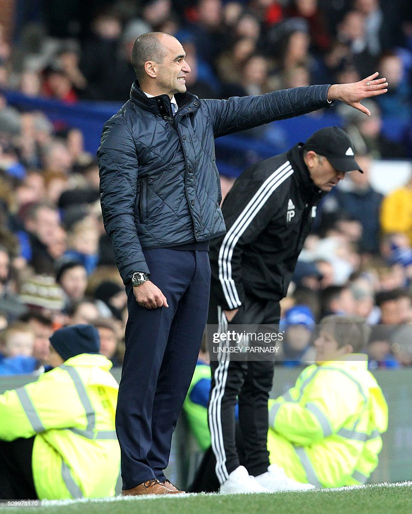 Everton's Spanish manager Roberto Martinez gestures during the English Premier League football match between Everton and West Bromwich Albion at Goodison Park in Liverpool, north west England on February 13, 2016. / AFP / LINDSEY PARNABY / RESTRICTED TO EDITORIAL USE. No use with unauthorized audio, video, data, fixture lists, club/league logos or 'live' services. Online in-match use limited to 75 images, no video emulation. No use in betting, games or single club/league/player publications. /