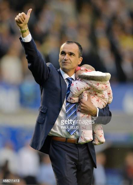 Everton's Spanish manager Roberto Martinez waves to fans after his team lost 23 during the English Premier League football match between Everton and...