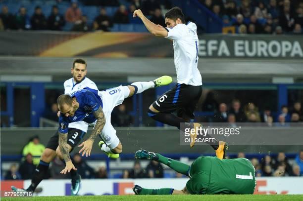 Everton's Spanish striker Sandro Ramirez clashes with Atalanta's Albanian goalkeeper Etrit Berisha resulting in his injury during the UEFA Europa...
