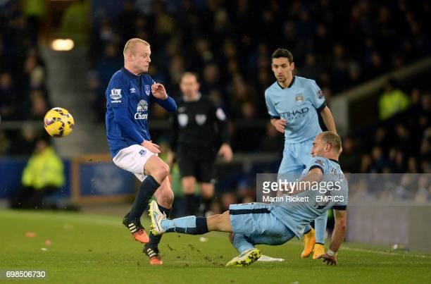 Everton's Steven Naismith and Manchester City's Pablo Zabaleta battle for the ball