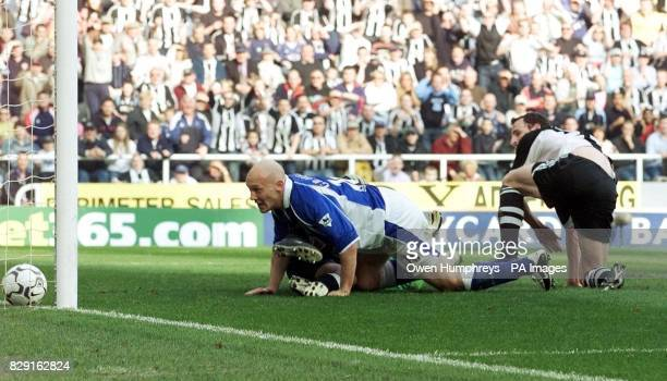 Everton's Thomas Gravesen can only watch as Newcastle United's Andy O'Brien scores United's third goal during their FA Barclaycard Premiership match...