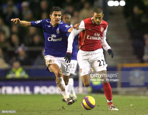 Everton's Tim Cahill and Arsenal's Gael Clichy battle for the ball