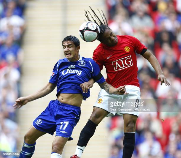 Everton's Tim Cahill and Manchester United's Oliveira Anderson battle for the ball