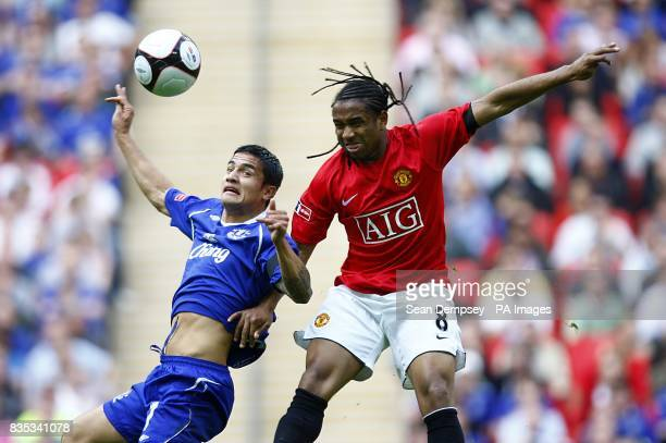 Everton's Tim Cahill and Manchester United's Oliviera Anderson in action