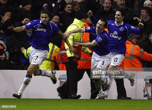 Everton's Tim Cahill celebrates scoring the equalising goal with team mates Mikel Arteta and Leighton Baines