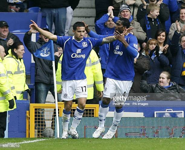 Everton's Tim Cahill celebrates with team mate Joseph Yobo after heading home the opening goal of the game