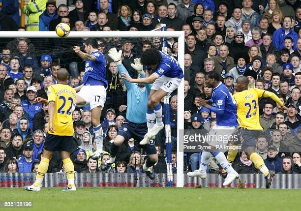 Everton's Tim Cahill rises high to head home the opening goal of the game
