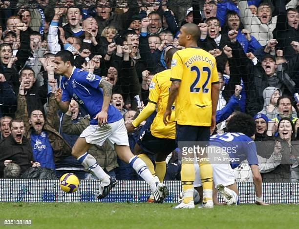 Everton's Tim Cahill runs away to celebrate after heading home the opening goal of the game