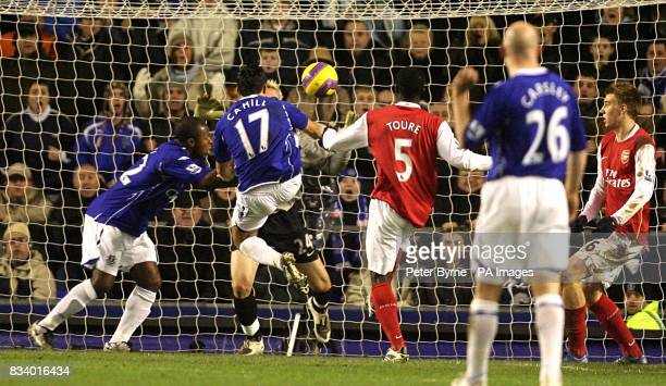 Everton's Tim Cahill scores the opening goal of the match