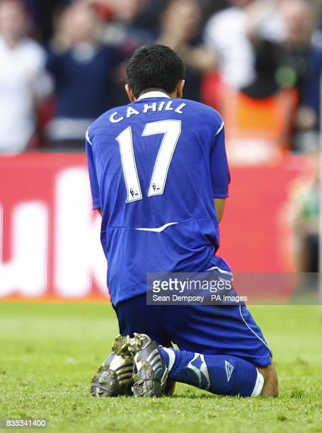 Everton's Tim Cahill sits dejected after missing the first penalty