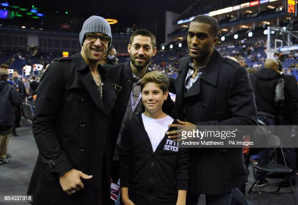 Everton's Tim Howard and Sylvain Distin with Tottenham Hotspur's Clint Dempsey during the 2013 NBA London Live match at the O2 Arena London