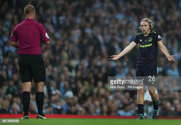 Everton's Tom Davies appeals to match referee Robert Madley