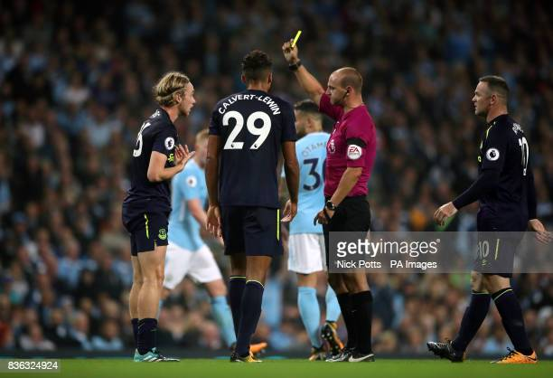 Everton's Tom Davies is shown a yellow card for simulation by referee Robert Madley during the Premier League match at the Etihad Stadium Manchester