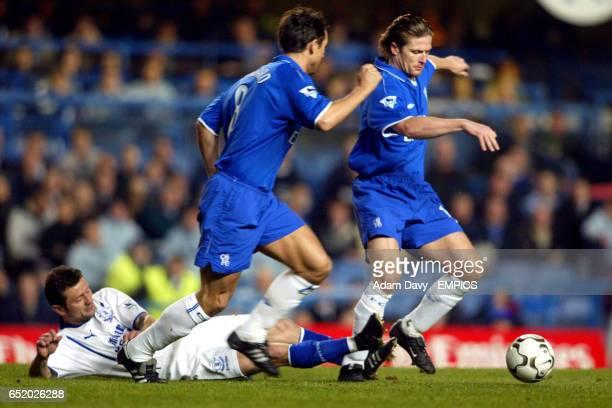 LR Everton's Tomasz Radzinski loses the ball to Chelsea's Frank Lampard and Emmanuel Petit