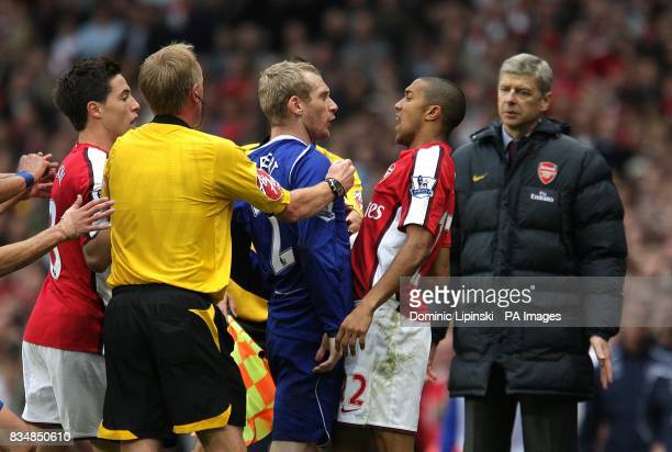 Everton's Tony Hibbert and Arsenal's Gael Clichy square up to each other
