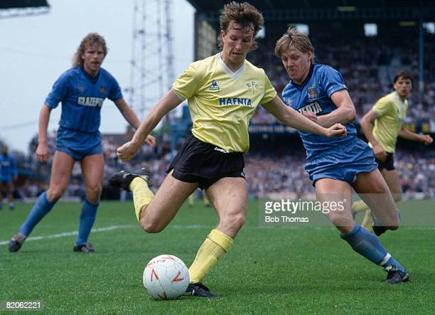 Everton's Trevor Steven crosses the ball as Coventry City defender Stuart Pearce moves in to tackle him during their First Division match at...