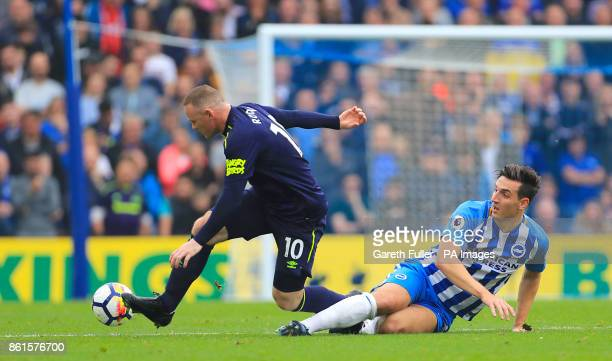 Everton's Wayne Rooney and Brighton Hove Albion's Lewis Dunk battle for the ball during the Premier League match at the AMEX Stadium Brighton