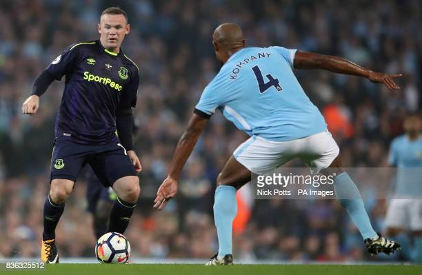 Everton's Wayne Rooney and Manchester City's Vincent Kompany battle for the ball during the Premier League match at the Etihad Stadium Manchester