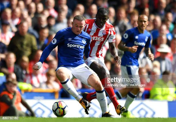 Everton's Wayne Rooney and Stoke City's Kurt Zouma in action during the Premier League match at Goodison Park Liverpool