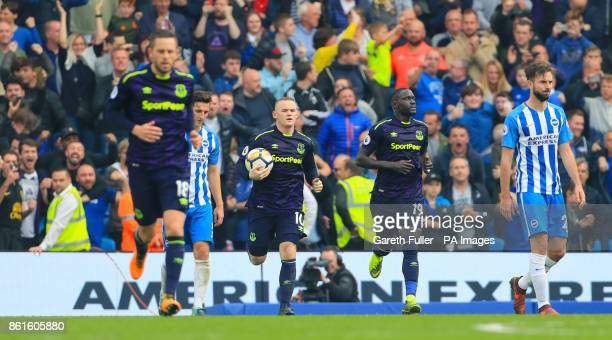 Everton's Wayne Rooney celebrates scoring his side's first goal of the game from the penalty spot during the Premier League match at the AMEX Stadium...