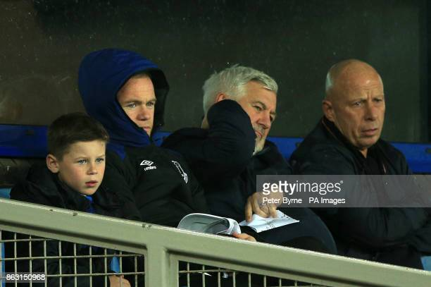 Everton's Wayne Rooney sits alongside his agent Paul Stretford in the stands during the UEFA Europa League Group E match at Goodison Park Liverpool
