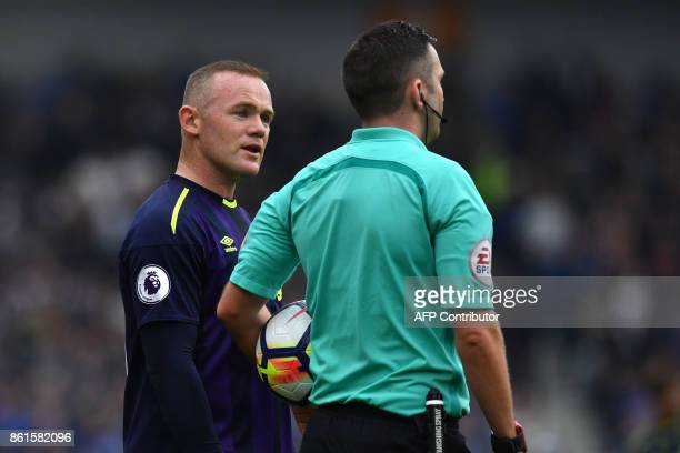 Everton's Wayne Rooney speaks to referee Michael Oliver during the English Premier League football match between Brighton and Hove Albion and Everton...