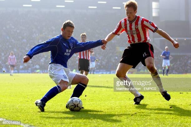 Everton's Wayne Rooney takes on Southampton's Michael Svensson