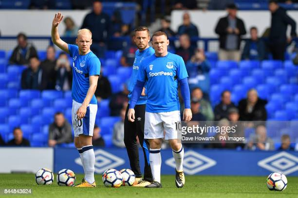 Everton's Wayne Rooney warms up with teammates Everton's Davy Klaassen and Everton's Gylfi Sigurdsson before the Premier League match at Goodison...