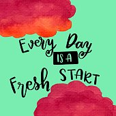 Every day is a fresh start handwriting message with painted clouds