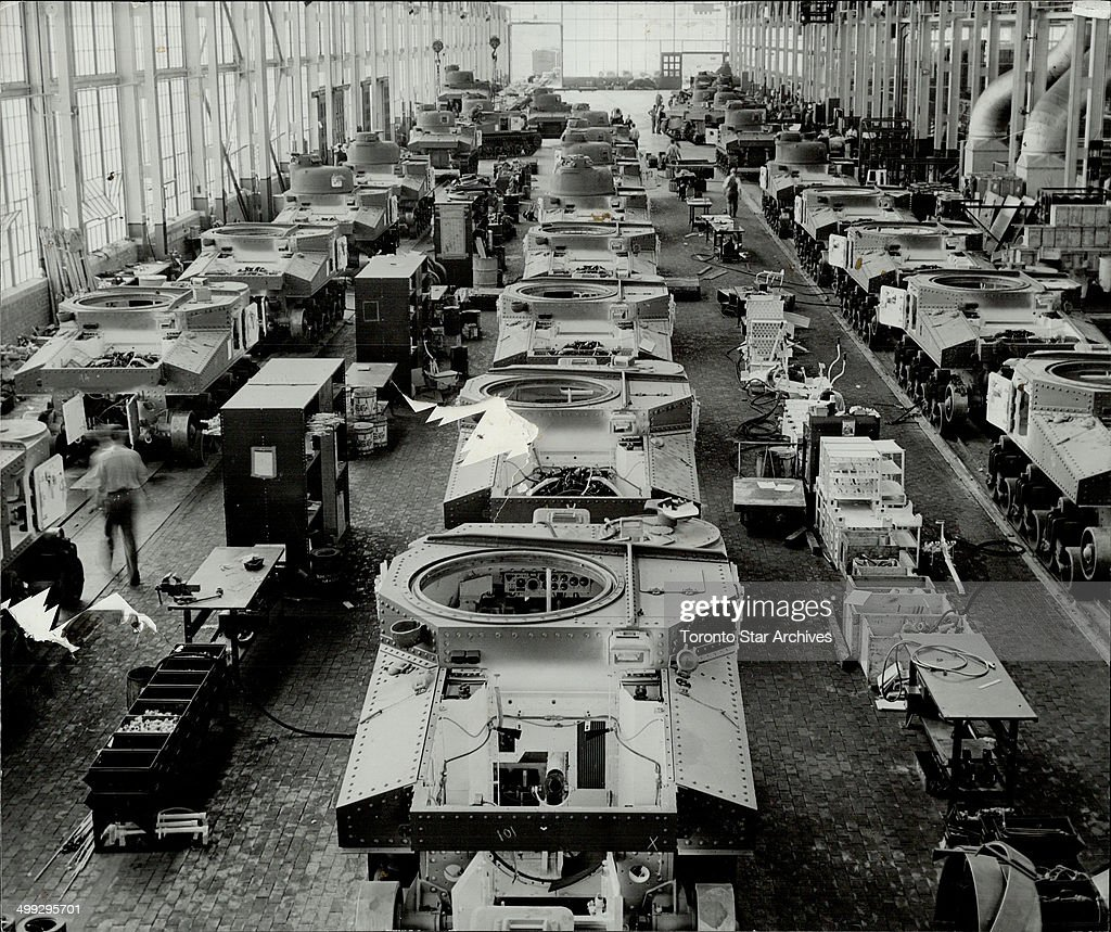 Every day more and more tanks are rumbling off production lines from factories throughout the United States Once geared to the high speed production...