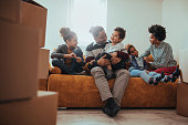 Family of five are playing together in their new home