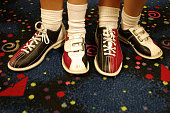Two pair of bowling shoes..adult and child.