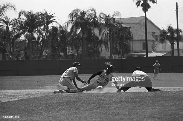 Everybody stretchesbut Pittsburgh right fielder Roberto Clemente is out at second after he attempted to steal when St Louis catcher Bob Uecker...