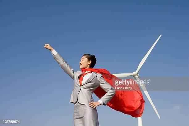 Everyday hero in front of wind turbines