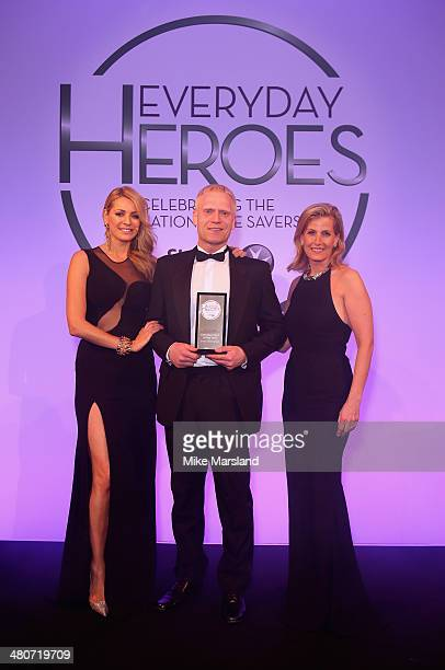 Everyday Hero of the Year award winner Simon Underwood with Tess Daly and Sophie Countess of Wessex on stage at the starstudded St John Ambulance...