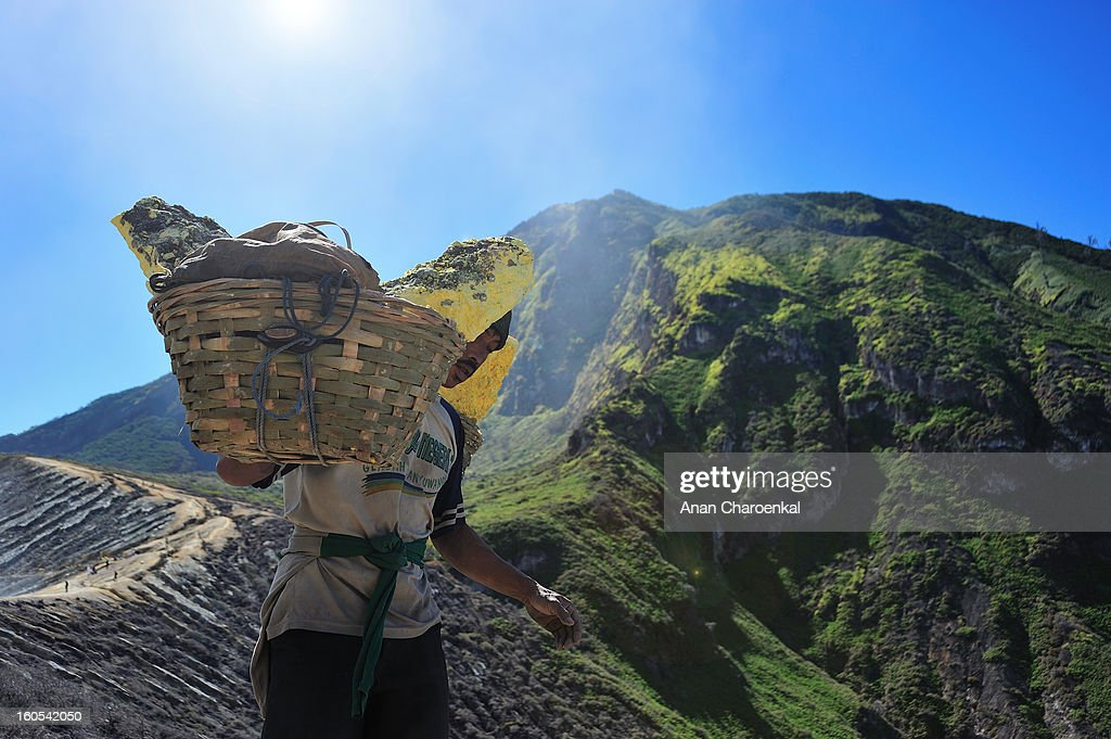 CONTENT] Everyday Indonesian mine worker who work in Kawah Ijen sulfur mine must carry heavy lump sulfur from the crater to foot hill for small wages.