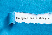 Everyone has a story written under torn paper.