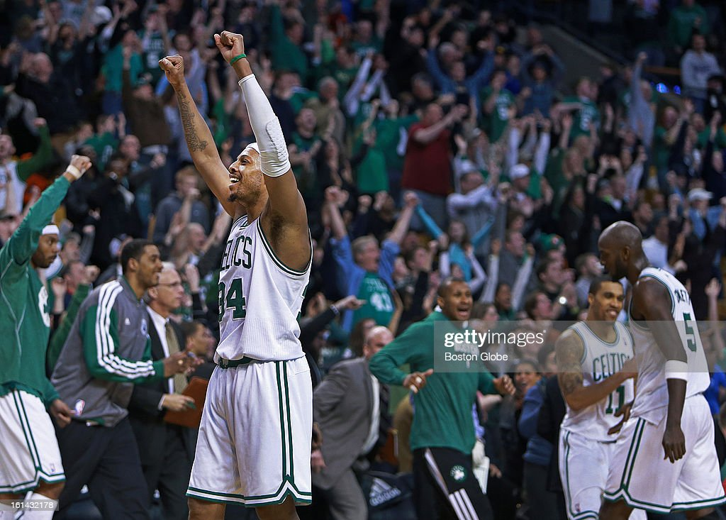 Everyone is happy, especially Celtics captain Paul Pierce (#34), as the final horn sounds in Boston's triple overtime victory as the Boston Celtics hosted the Denver Nuggets in a regular season NBA game at the TD Garden.
