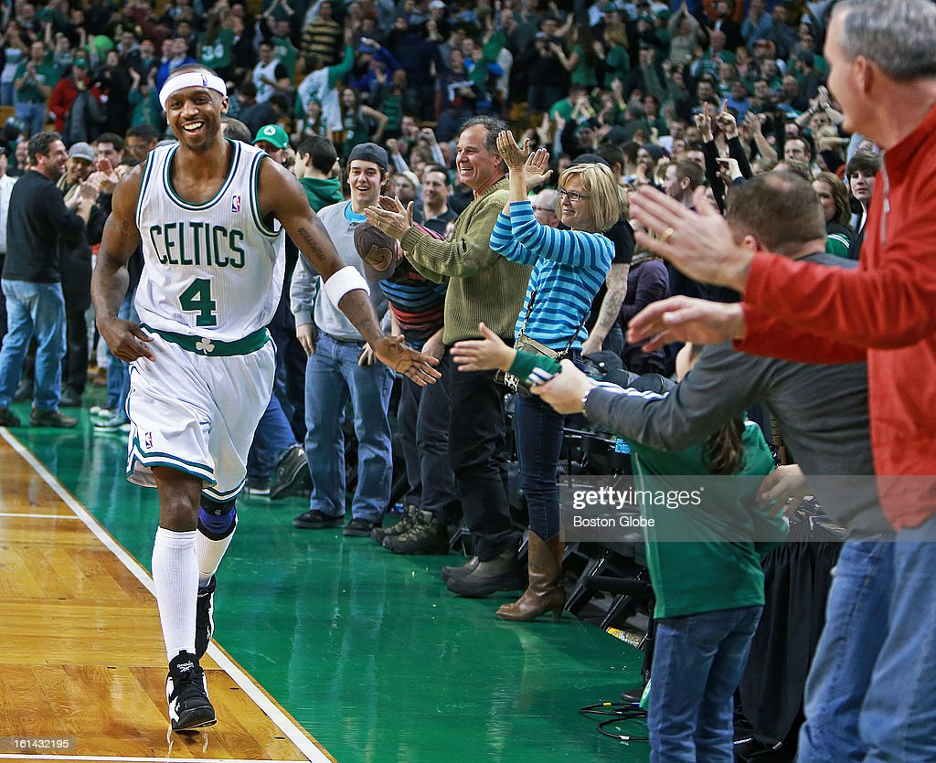 Everyone is happy, especially Celtics guard Jason Terry (#4) as he high fives fans after the final horn sounds in Boston's triple overtime victory as the Boston Celtics hosted the Denver Nuggets in a regular season NBA game at the TD Garden.