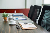 Table with notepads and coffee cups for business meeting