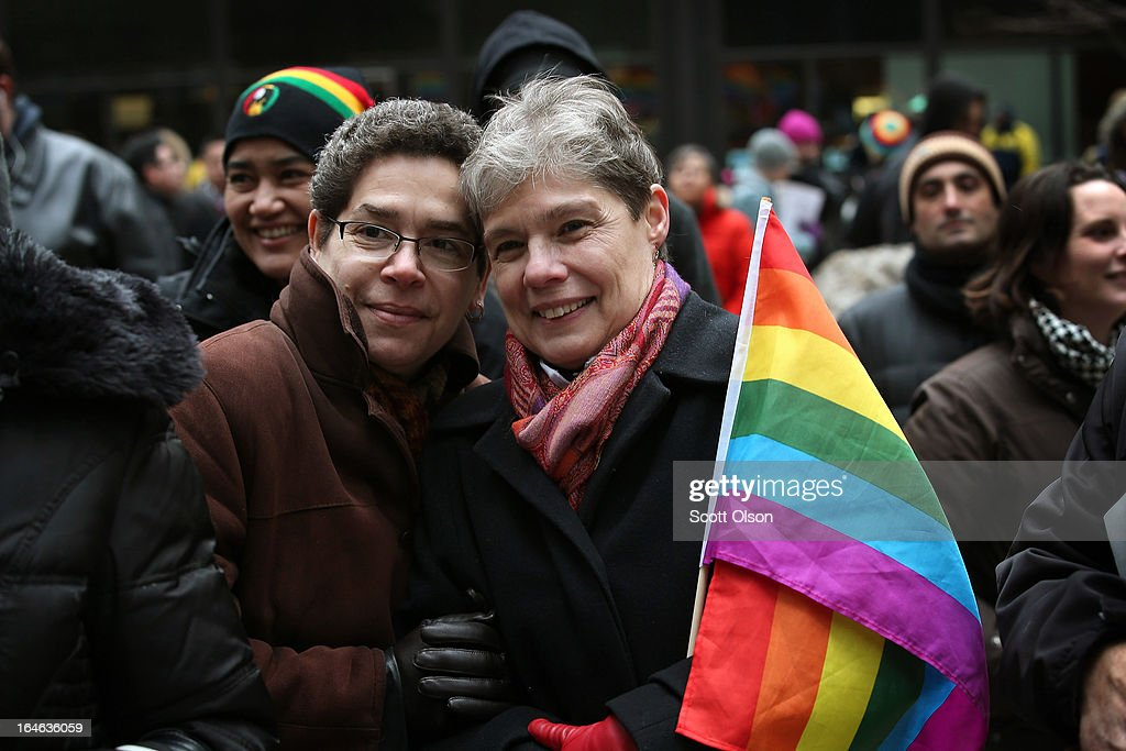 Evette Cardona (L) and her partner Mona Noriega participate in a rally in support of gay marriage March 25, 2013 in Chicago, Illinois. The Supreme Court will hear arguments this week in two cases that could determine if states or the federal government can treat same-sex couples and those of the opposite sex differently when recognizing a marriage. The Illinois Senate has approved legislation that will legalize same-sex marriage in the state but it still has to be approved by the Illinois House and signed by Governor Pat Quinn, who has said he supports the legislation. If passed Illinois would become the tenth state to allow same-sex marriage. Thirty states have defined marriage as a union between a man and a woman.