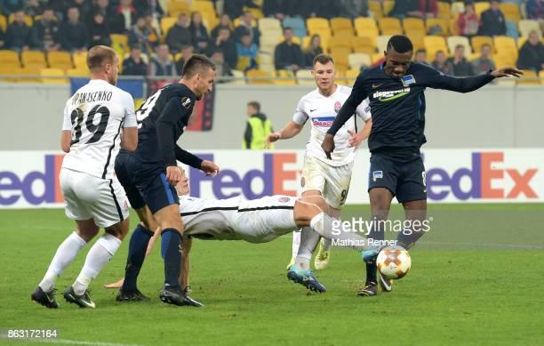 Evgen Opanasenko of FC Zorya Luhansk Vedad Ibisevic of Hertha BSC Oleksandr Svatok Silas of FC Zorya Luhansk and Salomon Kalou of Hertha BSC during...